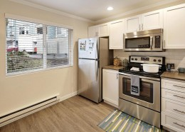 Kitchen with Stainless Steel Appliances - Hidden River Townhomes, Apartments near Juanita Bay, Kirkland, Washington 98034